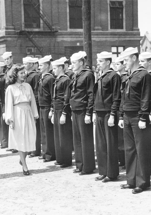 Paulette Goddard reviews a line of sailors during a visit to a Navy Yard -1940