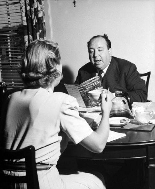 Director Alfred Hitchcock reads the novel Rebecca to Joan Fontaine.