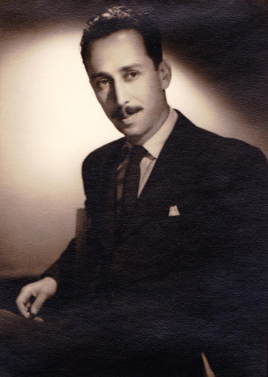 The photo is of mystery writer JOHN ROEBURT (my dad). You have him on your website for Inner Sanctum, Barry Craig, and other radio shows he wrote for (including the Shadow). He  won the Edgar Allen Poe Award for (given by the mystery writers of America, MWA) in 1948 for Inner Sanctum. He also wrote novels and film. I just noticed the pictures included on those web pages left my dad's photo blank. So here's a photo of John Roeburt.