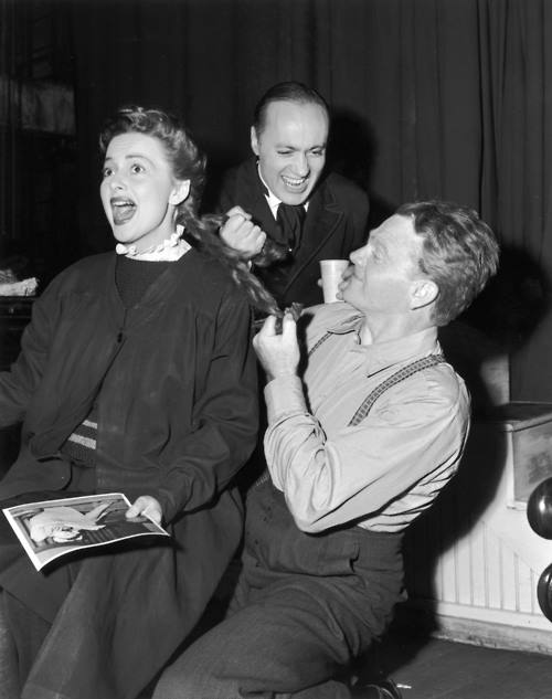 James Cagney and Charles Boyer pulling Olivia de Havilland's hair on the set of The Strawberry Blonde