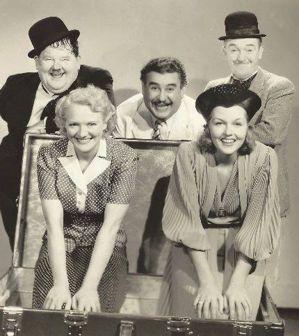 Oliver Hardy, Billy Gilbert, Stan Laurel and, from left, Minna Gombell, Patricia Ellis