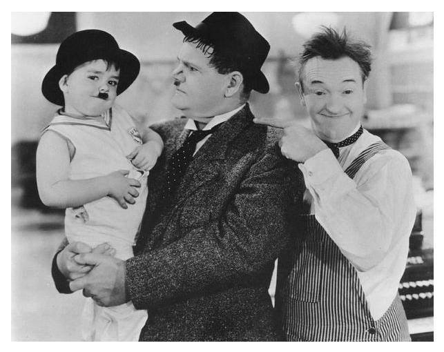 Oliver Hardy, and Stan Laurel