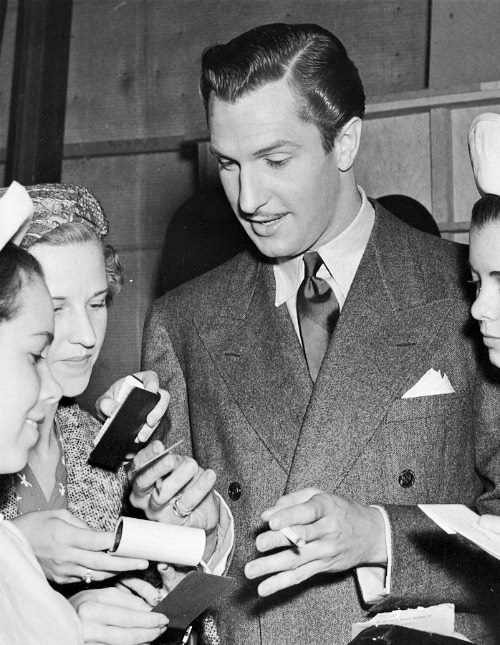 Vincent Price signing autographs for his fans