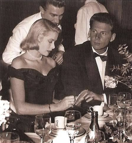 Grace Kelly with Jean-Pierre Aumont at a restaurant in '50s