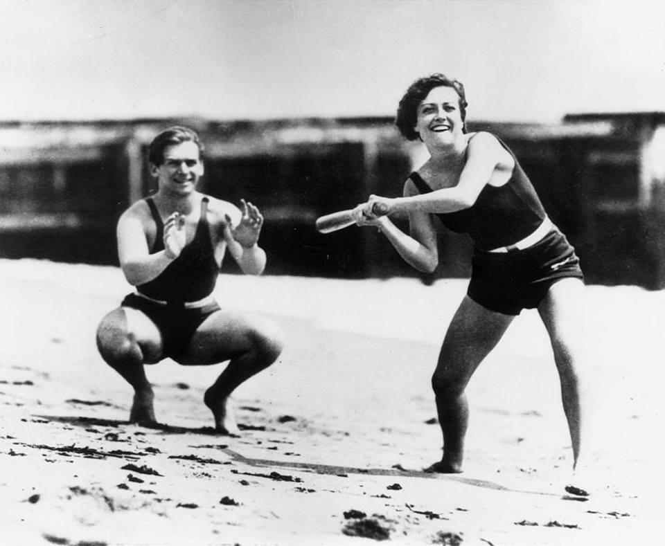 Joan Crawford and husband Douglas Fairbanks Jr playing softball on the beach, 1932