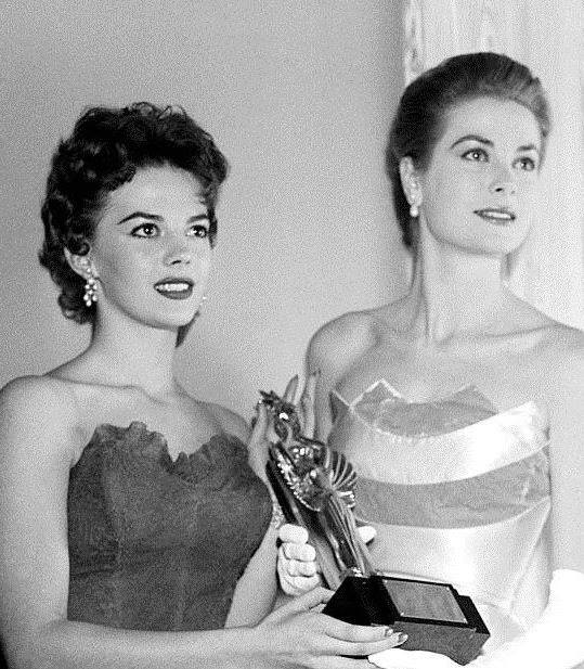 Grace Kelly and Natalie Wood accepting an Award for James Dean who had died on September 30, 1955)