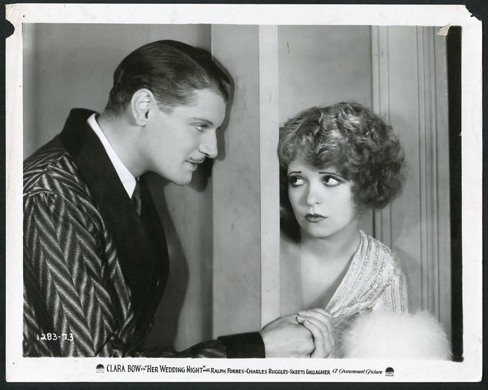 Clara Bow and Ralph Forbes in Her Wedding Night (1930).