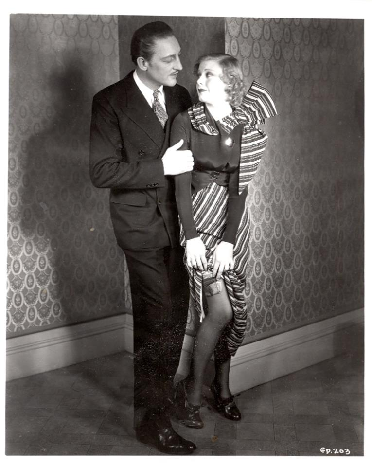 Warren William with Ginger Rogers