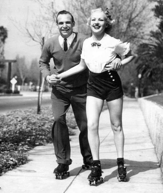 Jackie Coogan roller skates with his wife Betty Grable