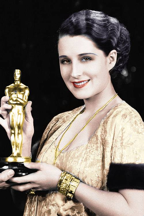 Norma Shearer receiving the Best Actress Oscar for her role in The Divorcee, 1930