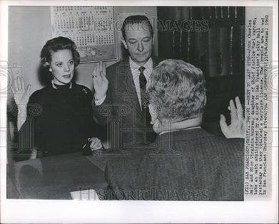 John Charles Daly and Miss Virginia Warren, daughter of Chief Justice Earl Warren, take an oath in San Francisco City Hall as they obtained a marriage license.