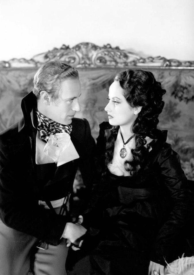 Leslie Howard and Merle Oberon
