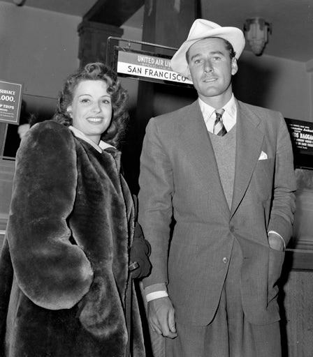 ERROL FLYNN with his first wife LILI DAMITA, at Los Angeles airport in 1941