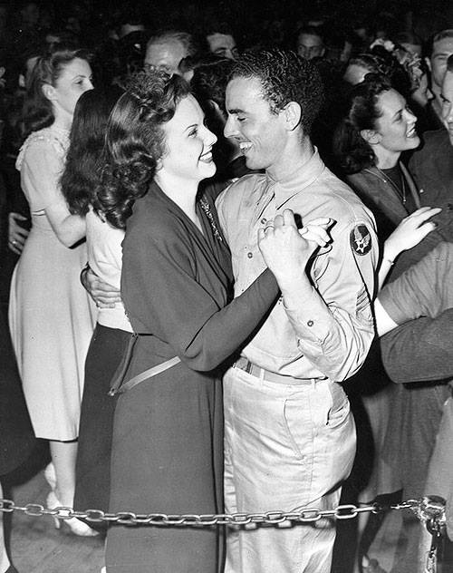 Actress, singer Deanna Durbin dances with an Army Air Force cadet at the Hollywood Canteen.