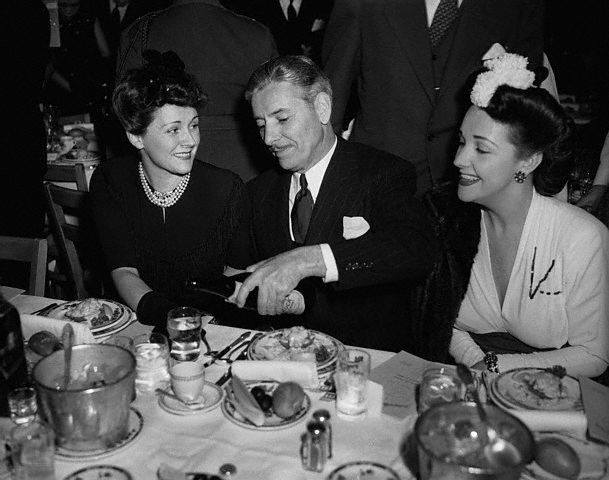 Ronald Colman with his wife Benita Hume (L) and Toni Lanier at the Academy Awards in 1943. in