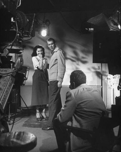 Actress Debra Paget laughs while rehearsing with James Stewart for the