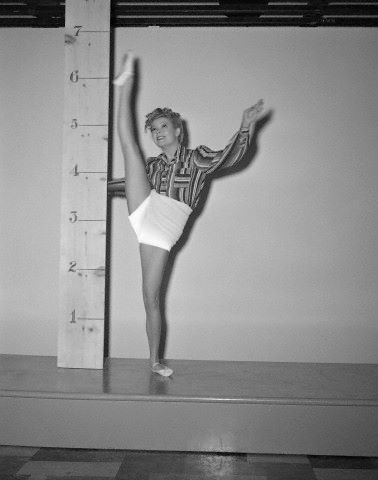 Actress Marjorie Reynolds pictured in 1942, documenting her record making of delivering the highest kicks on record for a dancer of her height.