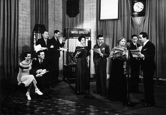 Shown left to right: Kathleen Wilson as Claudia, Barton Yarbrough as Clifford, Bill Andrews as announcer, Ed Ludes as sound effects man, Bernice Berwin as Hazel, Mike Raffetto as Paul Barbour, Minetta Ellen as Mother Barbour, Page Gilman as Jack and Anthony Smythe as Father Barbour.