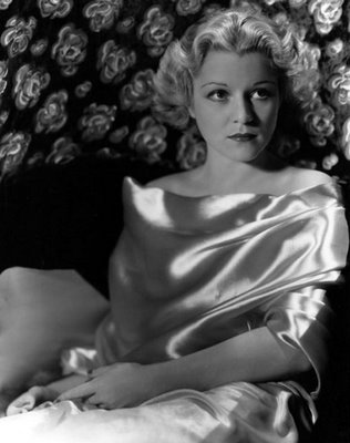 Claire Trevor as Theresa Travers