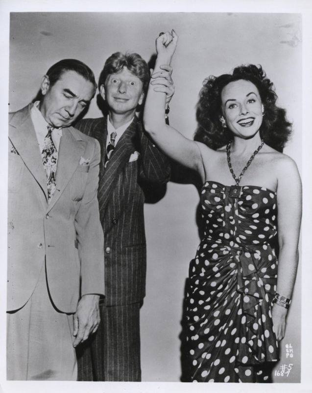 Paulette Goddard, Bela Logusi and Sterling Holloway (in the middle), in a Command Performance radio show.