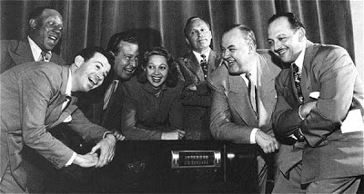 Jack Benny Program 51-01-28 Douglas Fairbanks, Jr  Jack and his gang are in New York for his television show and once again Jack is staying at that cheap hotel the Acme Plaza. Mary is staying at the Sherry-Netherland Hotel, and Jack arrives to take her to dinner before going to the studio, and is astonished at her luxury suite. Jack and Mary get to a restaurant where Jack spots Douglas Fairbanks, Jr and invites himself to Doug's table when no other tables are available.