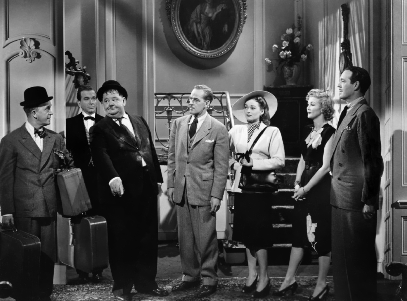 Laurel & Hardy with (L to R) Stan Laurel, George Melford, Oliver Hardy, Arthur Space, Doris Merrick, Veda Ann Borg, Philip van Zandt