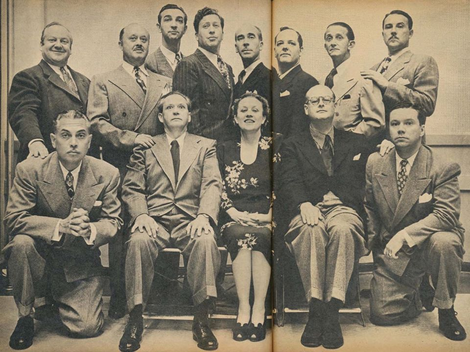 Cast of Fibber McGee and Molly  Front row:  Harlow Wilcox, Jim Jordan, Marian Jordan, Phil Quinn (writer), Bill Thompson.  Back row: Arthur Q. Bryan, Billy Mills, King's Men (Ken Darby, Rad Robinson, Jon Dodson, Bud Linn), Frank Pitman (producer), Gale Gordon.