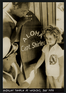 Shirley Temple is presented a commemorative surfboard during her 1935 visit to the Hawaiian Islands.