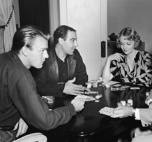 The rigors of being a perennial extra. Months of continual poker games with the likes of Virginia Bruce, who sits across from young 'Bud' Flanagan, ca. 1937