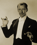 Elegant British society band leader Ray Noble provided both music and patter for Burns and Allen