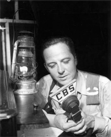 War reporter John Charles Daly gives his radio report by the light of a kerosene lantern, ca 1941