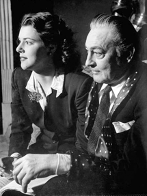 John Barrymore sits pensively fingering a script at home with his daughter Diana in 1942