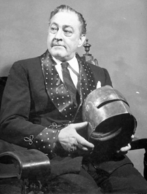 John Barrymore holds his helmet from Richard III at home in 1942