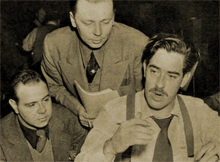 Jackson Beck and Paul Luther confer with William N. Robson during Man Behind the Gun (1943)