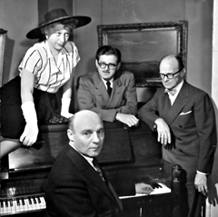 Corwin, flanked by Regina Reynic to his right and Deems Taylor to his left, with Bernard Rogers at the piano, ca. 1947