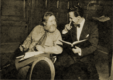 Charles Laughton consults with Fletcher Markle over the 'South Riding' script
