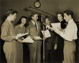 Walt Disney and Clarence Nash (center) visit WSM, Nashville studios to join the cast of Wormwood Forest. Nash was the voice of Donald Duck and Walt Disney himself voiced Mickey Mouse for the guest visit.
