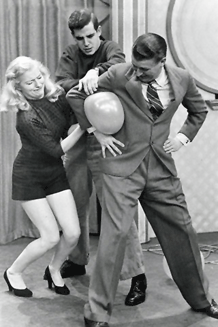 Bud Collyer rehearses one of the gags for his Beat The Clock game show, ca. 1954
