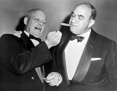 Two business legends, AFL-CIO leader George Meaney on the left, lights a cigar for Real Estate Tycoon William Zeckendorf, ca. 1956
