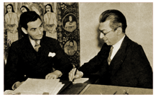 Dr. Frank Black (right) discusses arrangements with Irving Berlin (1936)