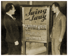 Sammy Kaye (right) admires his new signage for his Swing and Sway with Sammy Kaye road show (1938)