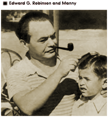 Candid shot of Eddie Robinson running a comb through Eddie Jr.'s hair. ( Eddie Jr.'s nickname was Manny, after his father's real name)