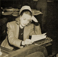 Ona Munson, as Lorelei, reviews 'copy' one last time as her deadline approaches.