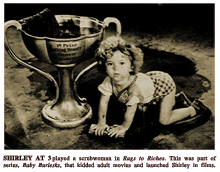 LIFE magazine article caption reads -- 'SHIRLEY AT 3 played a scrubwoman in Rags to Riches. This was part of series, Baby Burlesks, that kidded adult movies and launched Shirley in films.'