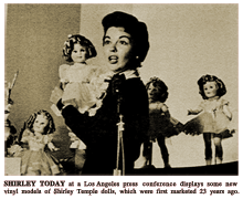 LIFE magazine article caption reads -- 'SHIRLEY TODAY at a Los Angeles press conference displays some new vinyl models of Shirley Temple dolls, which were first marketed 23 years ago.'