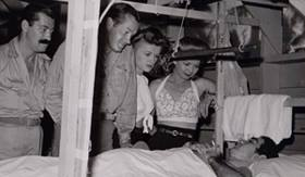 Bob Hope and his USO troupe visiting a hospital ward in the South Pacific (from left) Tony Romano, Jerry Colonna, Bob Hope, Patty Thomas, and Frances Langford,