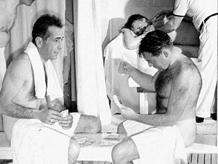 Humphrey Bogart and Peter Lorre enjoy a spritz together in Beverly Hills, ca. 1940