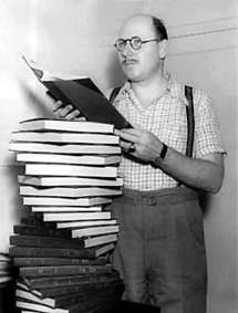 Carlton E. Morse with a stack of some of the books of scripts from One Man's Family over the years
