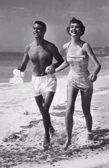 Cary Grant and Betsy Drake frolicking at the beach