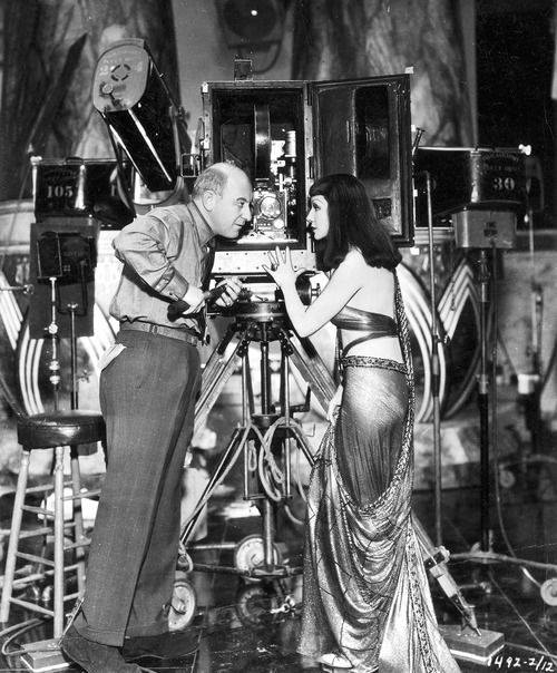 Claudette Colbert and Director Cecil DeMille on the set of Cleopatra